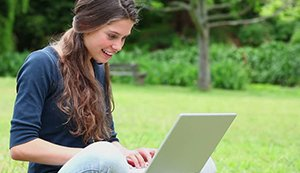 Women smiling with laptop